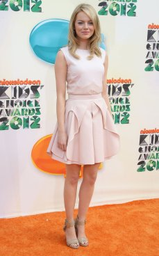Emma Stone looks like a doll in this porcelain pink tea party dress.